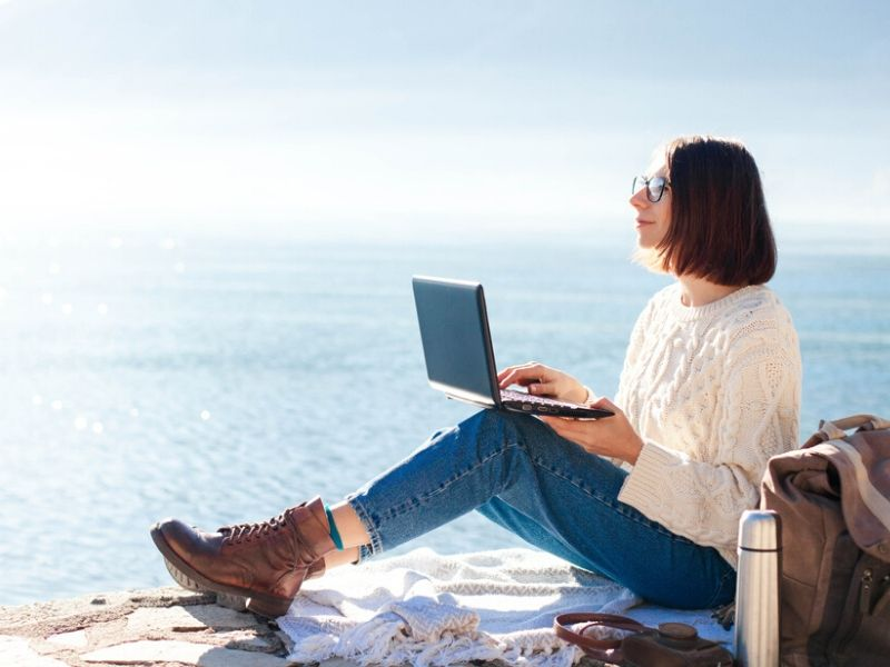 freelancer working by the beach